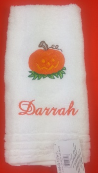 Smiling Pumpkin with Brown Stem Green Grass Hand Towel